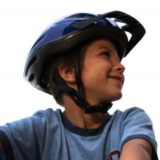 boy with auditory processing disorder rides bike