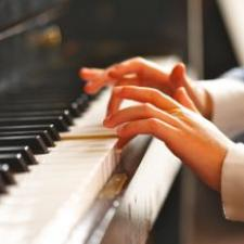 Child with central auditory processing disorder playing piano.
