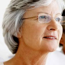 Senior woman contemplates uncovering hearing loss denial.