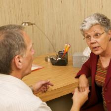 A caregiver tries to convince his argumentative mother of her hearing loss.