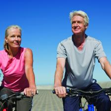 Couple with hearing loss on bikes.