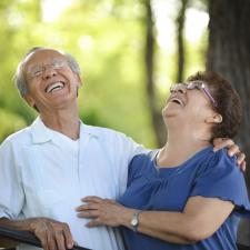 Laughing couple knows about improving hearing aid sound.