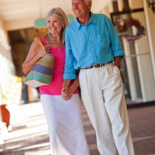 Tilted picture of older couple walking demonstrates hearing's affect on balance.