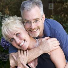 Couple hugging. Hearing aids improve relationship and love lives.