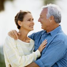 Couple holding each reconnected after hearing aids