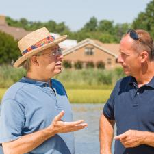 Two men discuss the latest hearing loss solutions