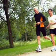 Two people running. People who use hearing aids are more active and social.