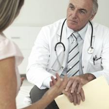 Audiologist speaks to patient about ototoxicity
