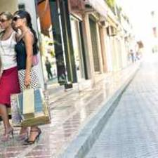 Women window shopping consider their options for new hearing aids.