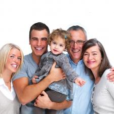 Family poses for pediatric hearing aid review