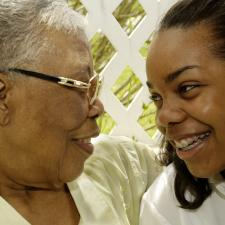 Grandmother and granddaughter discuss hearing aid benefits.