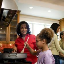 Family in kitchen cooking good meals for diabetics.