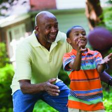 High self-esteem helps this grandfather and his grandson enjoy playing football together.