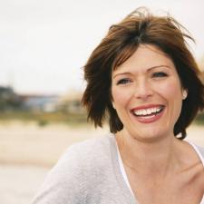 Woman smiles about amazing benefits of good hearing
