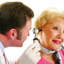 Woman having a hearing loss ear exam