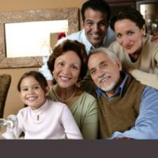 Family at dinner discusses best food for hearing health.