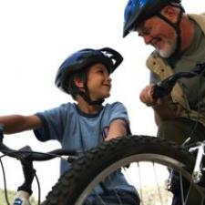 Grandfather and grandson discuss Top Articles on Childhood Hearing Loss