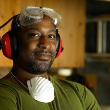 Worker wears hearing protection