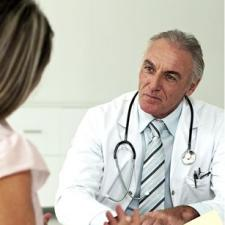 Doctor talks with patient about Meniere's Treatments
