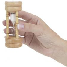 Hand holds hourglass as reminder to hear better now