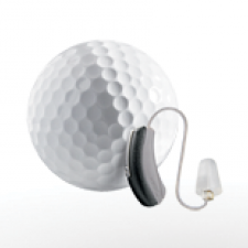 Widex behind-the-ear hearing aid is considerably smaller than this tiny golf ball.