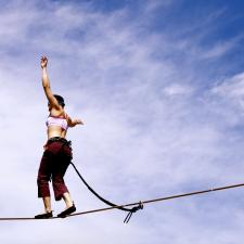 Woman on tightrope. Balancing the need for medication against its side effects can be difficult.