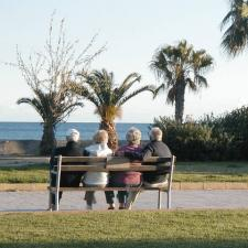 couples on bench at beach