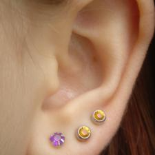 Ear with three piercings.