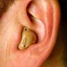 In-The-Ear hearing aid, a full shell occupying the entire outer ear.
