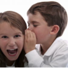 Kids whispering. Hearing loss and learning disabilities have been connected.
