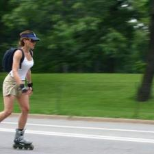 Woman rollerblades with hearing aids.