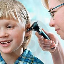 Child getting a hearing exam