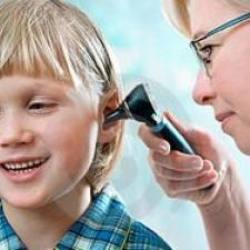 A child receive ear exam after getting vaccine to prevent childhood ear infections