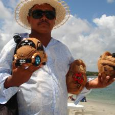 Man with coconuts