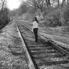 Girl on train tracks
